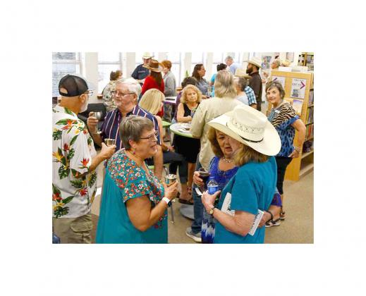 A group of Bandera locals enjoy conversation and libations at the Bandera Chamber of Commerce's latest Cork Popper event, which featured a book signing by local political cartoonist Dennis Allyn. BULLETIN PHOTO/Tracy Thayer