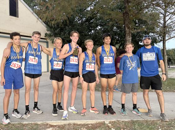 Bandera High School's cross country boys varsity runners pose with their second-place plaque after competing in the Alamo Heights Invitational on October Seven. The team was led by Braden Cox, center, who placed fourth with a time of 16:58. The team com