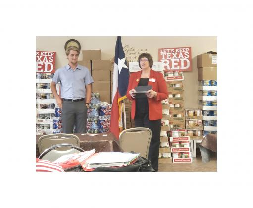 Susan Junker (right), Legislative VP for the Bandera County Republican Women Club, introduces Hunter Beaton, President and CEO of Day-One Bags, during the club's meeting on August 5. BULLETIN PHOTO/Tracy Thayer