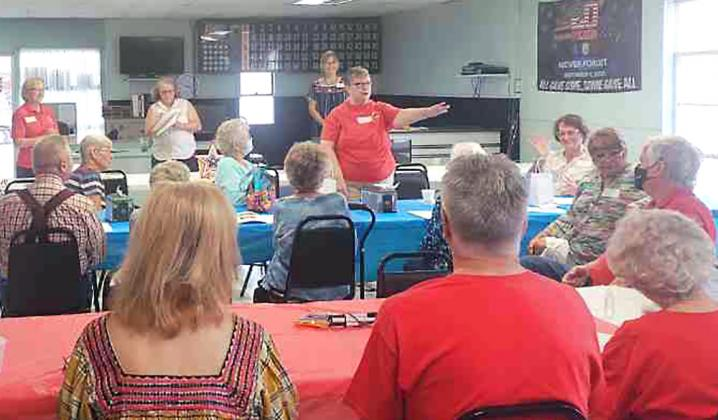 The Bandera County Retired Teachers met at the American Legion Post 157. Standing (in red) are President Connie Young at left and Treasurer Sharon Anderwald. BULLETIN PHOTO/Tracy Thayer