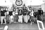 """BULLETIN PHOTO/Bill Pack                      Jeff """"Shooter"""" Butz, commander of the Alamo Chapter of the Combat Veterans Motorcycle Association, ninth from left, and other members of the chapter, pose with Cindy Stevens, seventh from left, the exe"""