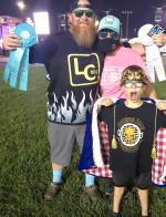 Local Philip Breeden, posing with wife Carmen, holds up his ribbons after placing 12th overall and third in ribs competition at the 41st World Series of BBQ in Kansas City, Kansas, the weekend of September 16-19. Also pictured is their eight-year-old son,