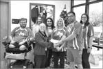 """COURTESY PHOTO                      Jeremiah """"JT"""" Trombly, operations manager for the Bandera Youth Soccer Organization, second from right, makes a donation of more than $2,650 to Bandera Independent School District Food Services Administrative As"""