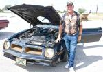 Former County Commissioner Doug King brought four classic cars to the American Legion Auxiliary Car Show. Here, he is shown with his rare 1976 T-Top Trans Am. BULLETIN PHOTO/Tracy Thayer