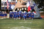 The Bandera Bulldogs charge out onto the field for last Friday's game against Comfort. Since it was Senior Night, members of the class of 2022 took to the field to pose with family and loved ones. For more photos, visit the Bulletin's facebook page. B